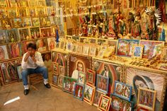 A vendor selling religious paintings and statues on the grounds of Basilica de Guadalupe.