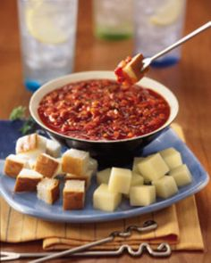 Slow cooker pizza fondue.Delicious fondue with mozzarella cheese and sausages cooked in slow cooker