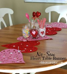 DIY No-Sew Heart Table Runner made from Dollar Store Heart Placements.  Just use ribbon to tie them together!  So easy!