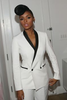 women in tuxedos   Janelle Monae's Swoop Curl Pomp and White Low-Cut Tuxedo
