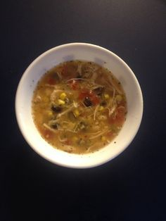 White chicken chili   1 cup water 1 lb chicken cooked & shredded 1 box chicken broth 1 can great northern beans-undrained 1 can black beans drained & rinsed 1 can diced tomatoes-drained  1 can corn  1 pkg of McCormick white chicken chili seasoning mix  Serve with sour cream and shredded cheddar cheese.