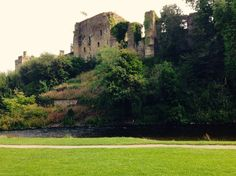 Castle ruins on the banks of the river Derwent Cockermouth, Cumbria , UK.