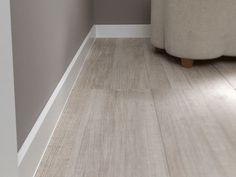 modern baseboards and matte flooring and