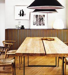 Recycled teak wood table, Hans J. Wegner chairs & oversized Tom Dixon pendants.