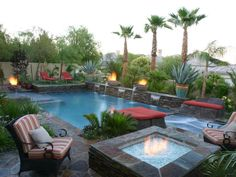 Influenced by ancient feng shui philosophies, interior designer Tannie Luke worked with Paragon Pools to craft this Asian-inspired pool. Fire pots and spillways line the pool's edge, while striped patio chairs cozy up to a raised fire pit.