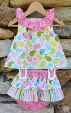 Cute as can be, this bloomer set matches the dress in today's flash sale and features a ruffled neck and ruffled bloomers. This outfit is true to size and the bloomers allow room for a diaper. This set is the perfect shower gift! Sizes: 9m, 12m, 18m, 24m & 2/3. Was: $55 Now: $32.