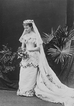 1879, Duchess Louise of Connaught, Princess, Duchess, Hohenzollern family, Welf family, straight coiffure, floral headdress, veil, lace, straight neckline, modesty piece, quarter length sleeves, over-skirt, tablier, under-skirt, pleats, floral bodice ornament, floral skirt ornament, floral train ornament, necklace, brooch, bracelets, wedding dress