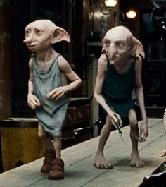 Dobby and Kreacher.I was really angry when they didn't show the scene that happens at the end of the book with Kreacher proudly leading all the House Elves in the Hogwarts kitchens to help in the battle. Dobby Harry Potter, Mundo Harry Potter, Theme Harry Potter, Harry Potter Love, Harry Potter Universal, Harry Potter World, Hogwarts, Big Hero 6, Animals