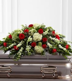 The FTD® Sincerity™ Casket Spray is a wondrous presentation of fresh color and beauty. Rich red roses and carnations are eye-catching and elegant in an arrangement of white hydrangea, larkspur, snapdr