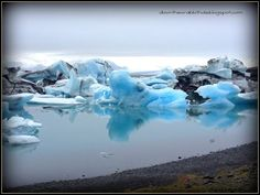 """Visit the majestic Iceberg Lagoon in Jokulsarlon, Iceland. Find out more at """"Down the Wrabbit Hole - The Travel Bucket List"""". Click the image for the blog post."""