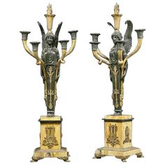 A Pair Of Empire Gilt And Patinated Bronze Candelabra  | From a unique collection of antique and modern candleholders and candelabra at http://www.1stdibs.com/furniture/lighting/candleholders-candelabra/