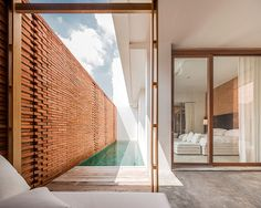 """onion sala ayutthaya boutique hotel curved brick walls white geometries thailand"""