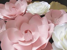 Create your own beautiful flowers with this amazing template. Purchase includes 8 different petals sizes, three different size circles, and links to videos and posts to help you get started on making beautiful paper flowers. Flowers can range from 20-5. VIDEOS can be found on my