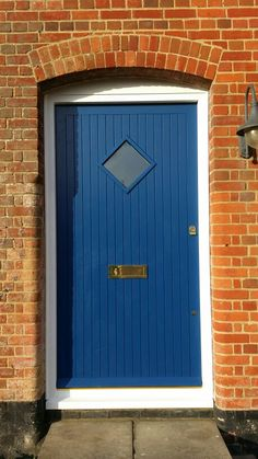 Accoya double boarded front door with diamond vision panel and brass hardware  www.thehampshiredoorcompany.co.uk