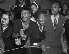 At a concert in Harlem, 1948. By Weegee.