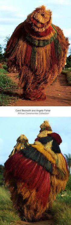 Africa | Zangbeto masks dance during Fon dry season masquerades.  Atakora Plateau, Benin | ©Carol Beckwith and Angela Fisher