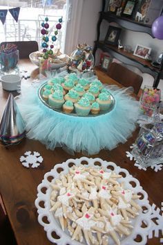 sugarplum fairy birthday party sugar cookies and snowflake sprinkle topped cupcakes http://theshortandsweetkitchen.ca