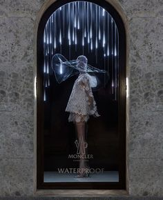 Type of display: Semi- Realistic. This visual display is promoting the waterproof outfit. The attention is drawn from the posture of the model and the neon lights hanging down around it, also the one-window display helps people focus just on the item