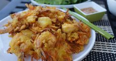 Banh tom Co Ngu (shrimp and yam fritters) is a very traditional  appetizer dish of Northern Vietnam. The yam or sweet potato is a qu...