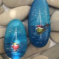hand painted rocks with a nautical theme