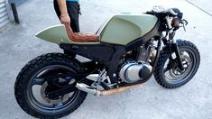 See a number of my most favorite builds - stylish scrambler bikes like this Suzuki Cafe Racer, Gs 500 Cafe Racer, Cafe Racer Style, Cafe Racer Build, Vintage Cafe Racer, Rockers, Bobber, Scrambler Moto, Gs500