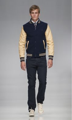 blue-yellow varsity jacket, dark jeans / men fashion