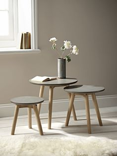 With a unique, faux concrete finish and weathered, grey ash wood legs, this set of three nesting tables brings a soft  touch of industrial style to your room. Soften with a vase of faux flowers,or team with bare floorboards and sheepskin for a Scandi inspired look.