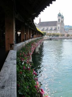 """Lucern, Switzerland on one of the bridges for which Lucern is famous and the Orthodox Church with """"onion domes""""."""