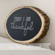 Live a Little Wilder: log slice chalkboard {tutorial}. This is such an awesome blog! Check it out.