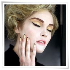 chanel ad with black tip french manicure
