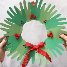 christmas crafts classroom CHRISTMAS HANDPRINT WREATH - this is such a cute keepsake and Christmas craft for kids! Love how each it is and it can be used to give as a gift too. Classrooms can make a big one. Great for preschool, kindergarten or toddlers. Christmas Arts And Crafts, Winter Crafts For Kids, Diy Christmas Cards, Christmas Activities, Kids Christmas, Holiday Crafts, Simple Christmas, Classroom Christmas Decor, Christmas Crafts For Kids To Make Toddlers