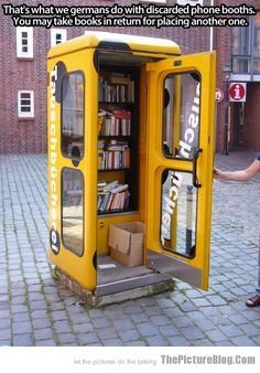 Phone booth library in Germany. Why can't America have phone booth with things like this? While your at it can you put a TARDIS in some place?