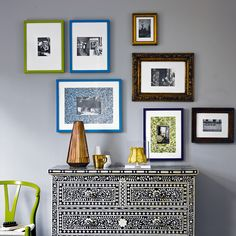 Living room with grey walls and colourful photo frames