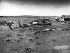 Dust Bowl - Dallas, South Dakota 1936.  Buried machinery in a barn lot; South Dakota, May 1936. The Dust Bowl on the Great Plains coincided with the Great Depression.