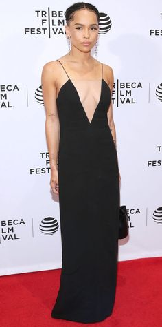 Zoe Kravitz took the plunge at the Vincent N Roxxy premiere during the 2016 Tibeca Film Festival in a slinky Alexander Wang slip dress with a navel-grazing neckline that had a see-through illusion panel. Sweeping drop-chain earrings and a minimalist bucket bag, also by Alexander Wang, completed her red carpet look.  Look of the Day - Zoe Kravitz - from InStyle.com