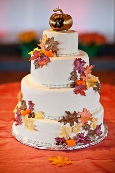 A pumpkin-topped cake inspired by the fall foliage.  Photo Credit: C. Tyson Photography (=)