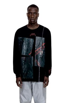This black long sleeve T shirt exhibits a sparse, striking design. The graphics on the front display industrial, Escheresque imagery, skeletal scaffolding overlaps and fills the dense space allocated – with the red punctuating the monochrome toning of the piece. The vinyl is framed by a trifecta of A-COLD-WALL* logos – one on each cuff … Continued