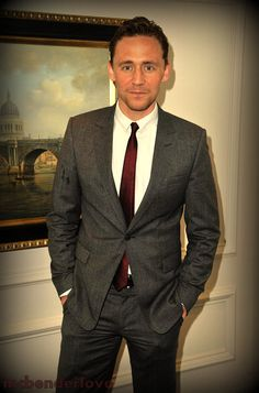 Tom Hiddleston    I never thought about a gray suit and dark red tie. That's actually a gorgeous combination.