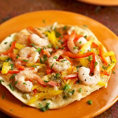 A thin flour tortilla crust ensures that the shrimp and peppers on this pizza take center stage. And don't worry about counting slices -- you get the whole pizza for 269 calories.   /