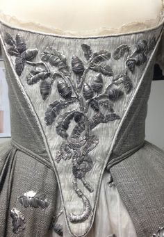 Silver embroidery in oak leaf and acorn motif. Claire's wedding dress detail.