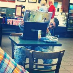 A soldier reading a story to his child through skype...priceless.
