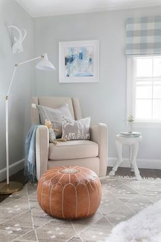 Great spot to cuddle up and read, featuring the Tobacco Moroccan Pouf