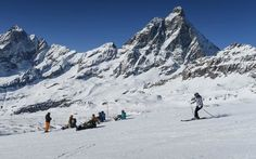 Skier and snowboarders in front of the Matterhorn in Cervinia, Italy