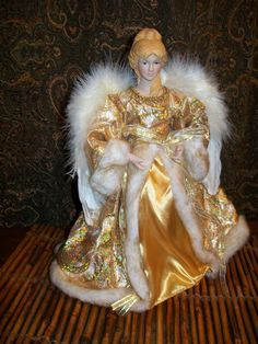 http://www.ebay.com/itm/Blonde-Angel-Tree-Topper-Table-New-old-stock-Gold-Dress-Blond-hair-Victorian-/190605653373?pt=LH_DefaultDomain_0&hash=item2c60fb757d  New Old Stock.    Christmas Angel Tree topper  Use as a decoration on your table display      Measures Approximate: 12 inch high  Color:  Dress is gold  Hair:  Blonde  Porcelain head and hands  Condition:  New Old stock    Wings of an Angel and so beautiful for your Christmas.  This angel looks a little Victorian or could go with the…