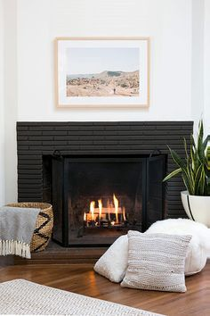 Our Marin frame looks lovely over this fireplace, don't you think? | Via @100layercake