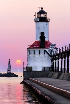 Michigan City Lighthouse, Sailboat, and Sundown by Kenneth Keifer. Photograph taken in Michigan City, Indiana on the East Pierhead Breakwater.