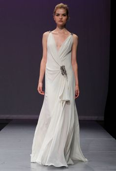 "Brides: Rivini - Fall 2012. ""Magdalena"" sleeveless silk chiffon sheath wedding dress with a plunging v-neckline and beaded accents at the shoulder straps and waist, Rivini"