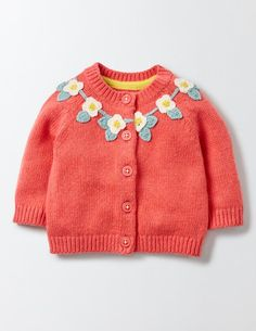 Keep tiny arms cosy on cooler days with our supersoft classic cardigan. Our sweet knit is decorated with delicate little crochet flowers around the collar for extra prettiness. This cotton and merino mix design is gentle on your little one's skin, but tough enough to handle a machine wash.