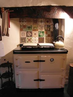 Rayburn - solid fuel burner will run without electricity, and heats water Tiny House Interior, Aga Kitchen, House Deck, Cottage Renovation, Kitchen Stories, Cottage Kitchens, Yellow Kitchen, Kitchen Dining Room, Kitchen Inspirations