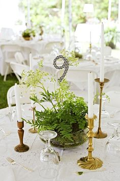collection of gold and brass candlesticks and lovely lace tablecloths